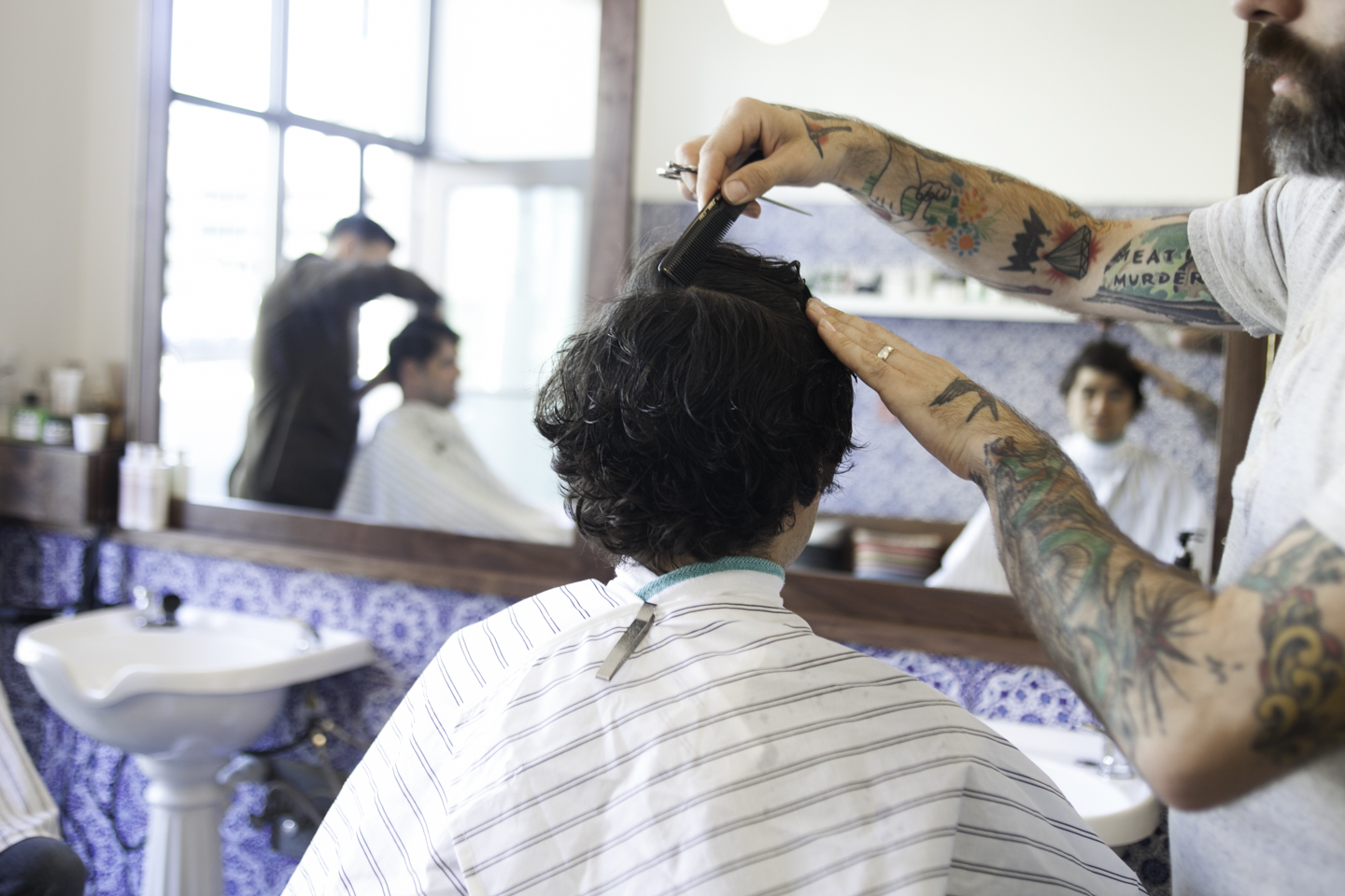 "Owners of Ritual Barbers, Chad ""Lue"" Lueck and Stephen Baraboo, maintain a loyal client base that appreciates a unique approach to each hair-cutting experience. The two-chair shop occupies a 10'x15' space on the outer loop of Madison's capital square."