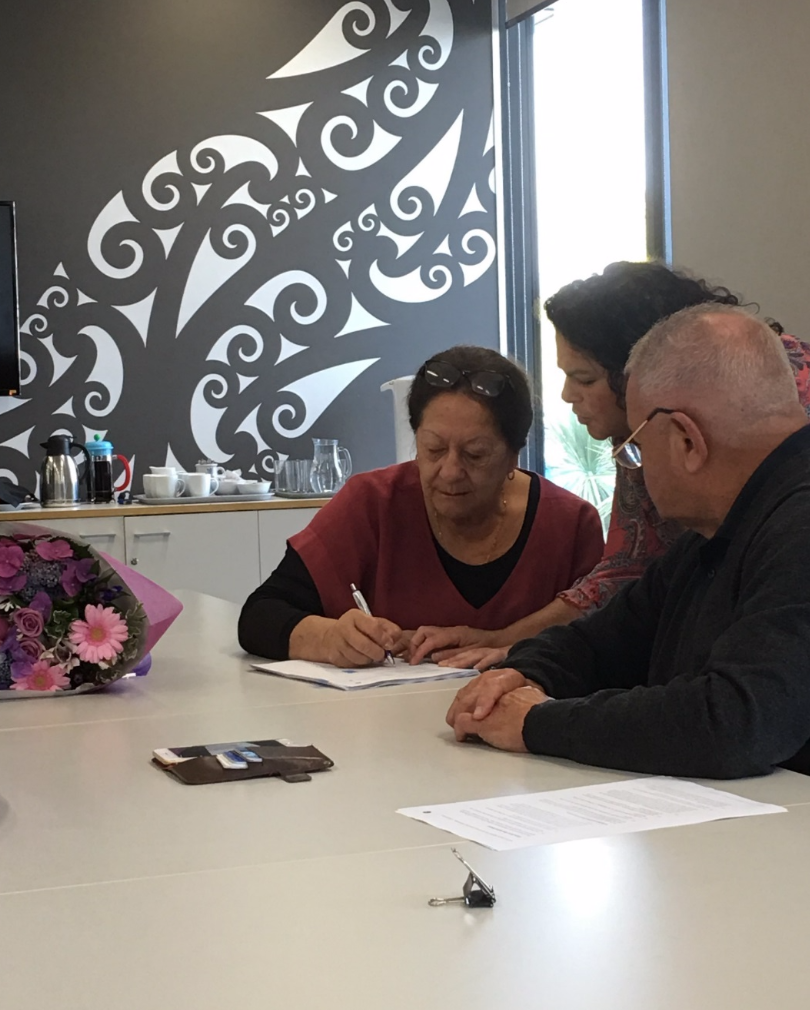 Whaea Molly Luke (Chair of Te Taumata) signing off, alongside of Matua Norm Dewes (Chairperson of the GPL Board) with Carmen Hammond showing the way…