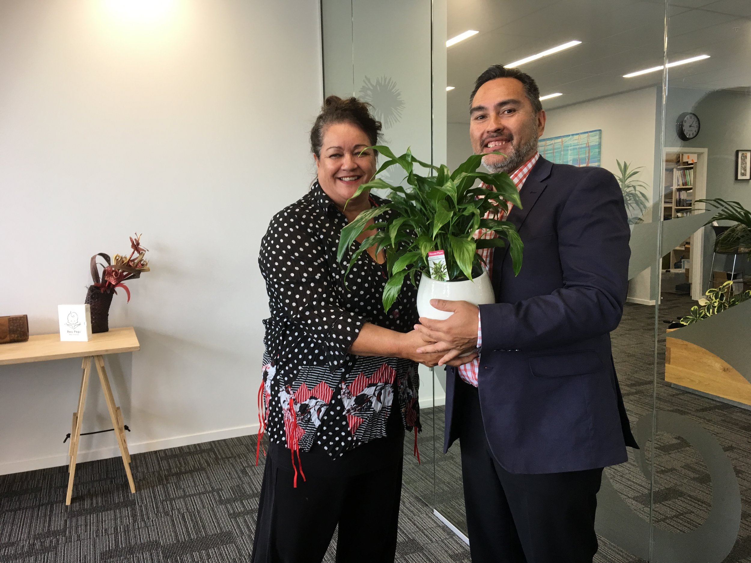 Trisha Harrison-Hunt gifting David Ormsby with the 'peace lily