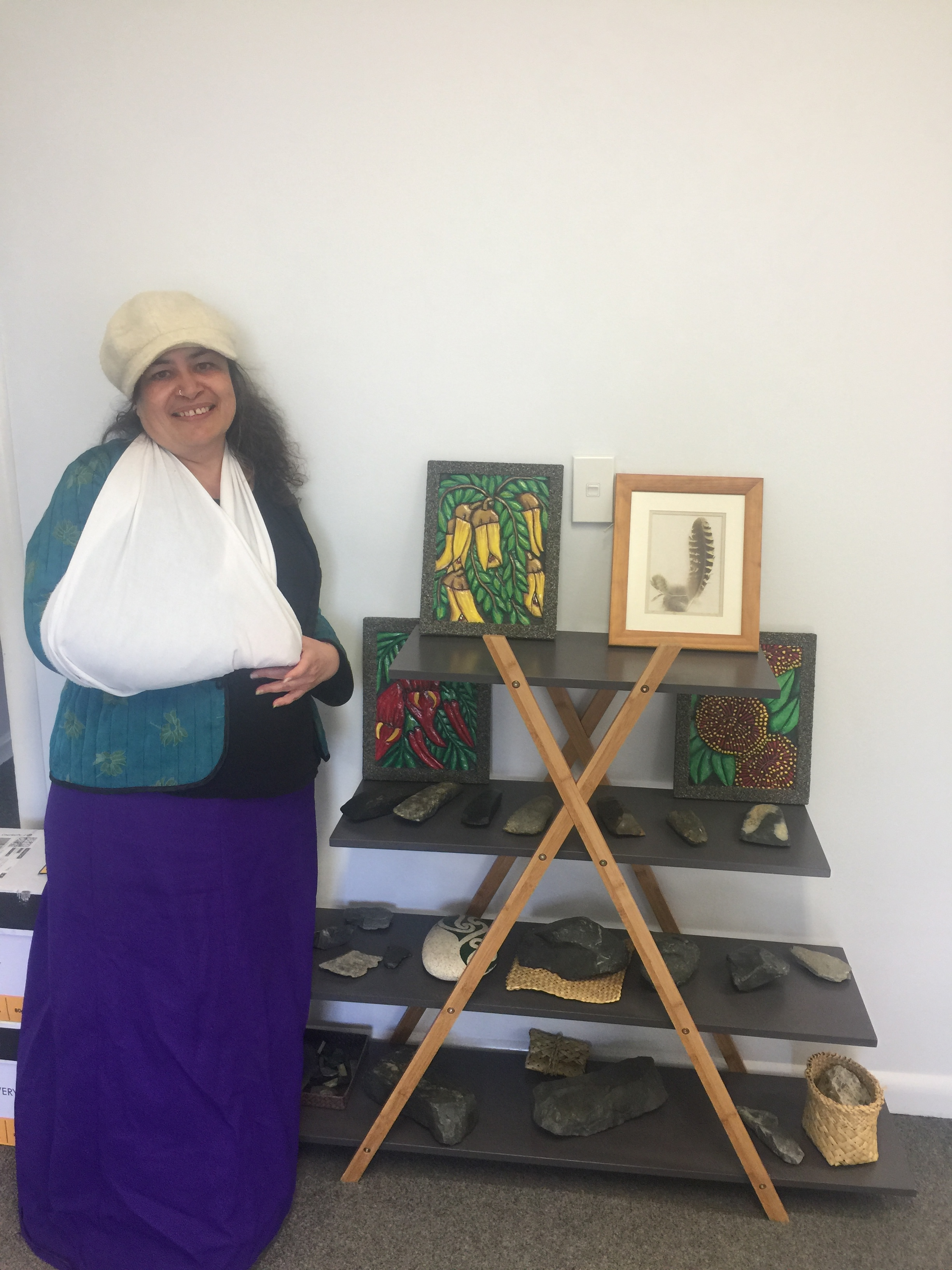 Noel Hemi with some of her artwork