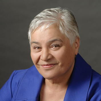 Hon Dame Tariana Turia was a New Zealand member of Parliament from 1996 until 2014. She was Minister for Whānau Ora; Disability Issues and the Community and Voluntary Sector. She has also been Associate Minister in Health, Maori Affairs, Social Development, Child, Youth and Family; Housing, Corrections, Tertiary Education, Skills and Employment. Dame Tariana has been a champion of rangatiratanga for Māori as well as advocating strongly for disabled persons and Pasifika communities. Before entering politics, Dame Tariana was the chief Executive of Te Oranganui Iwi Health Authority (the longest and largest Māori Health Service provider in the Central Region). Dame Tariana was co-leader of the Māori Party since its inception in 2004 until November 2014. Two of her greatest achievements are in Whānau Ora and tobacco reform. Whānau Ora represents a transformation in the way services are designed and delivered, contracts arranged, and providers work together. It is a bold and innovative approach which places the aspirations and outcomes for whānau at the centre.