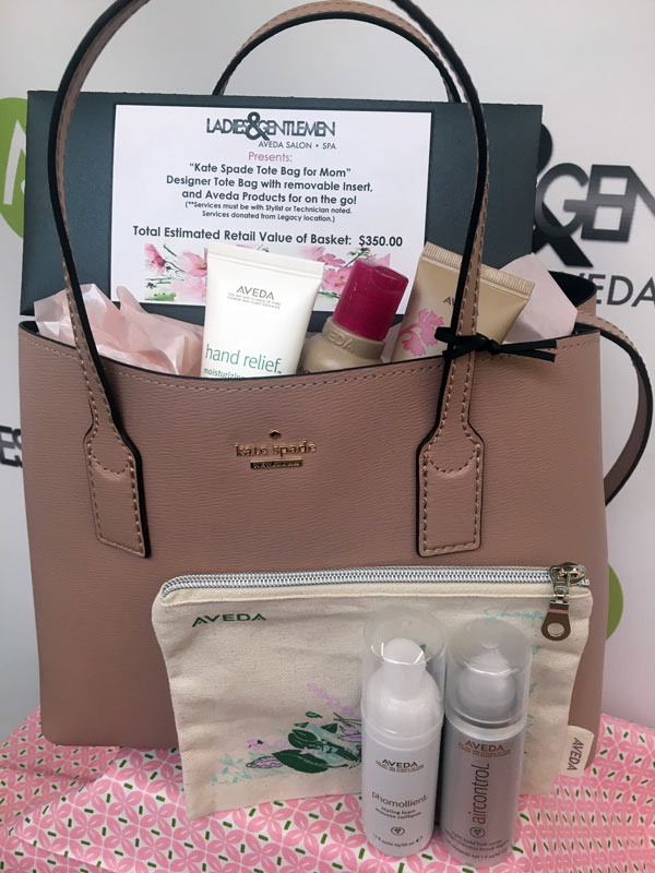 Kate Spade purse with Aveda products for on the go