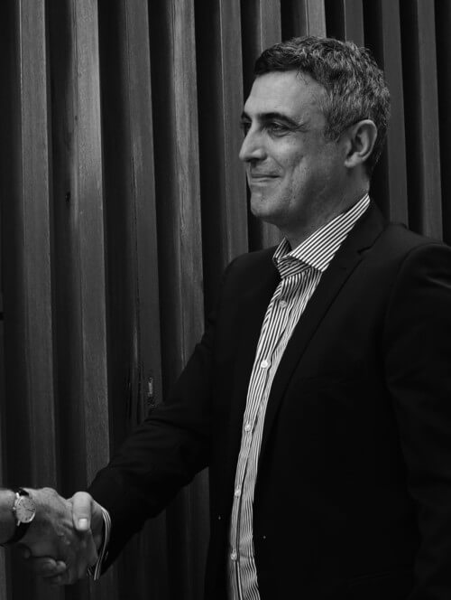 Australian Immigration Lawyer and Registered migration agent shakes hands with client