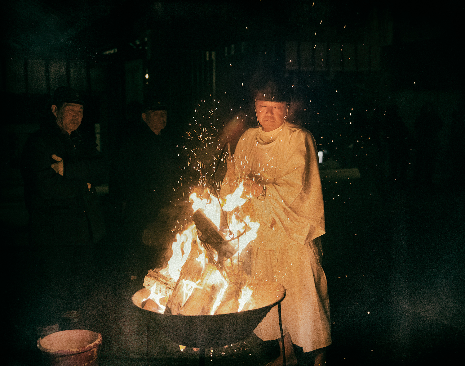The Yoi-Matsuri ceremony, the night before the Aofushigaki Ritual at Miho Shrine. The man responsible for the lantern touch keeps the fire alive during the ceremony.
