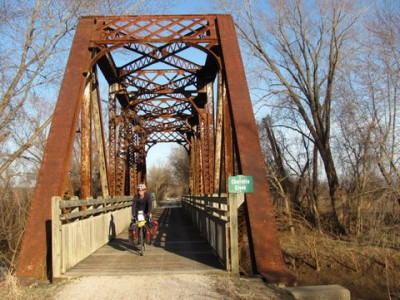 An old truss bridge reminds us it was once a rail line