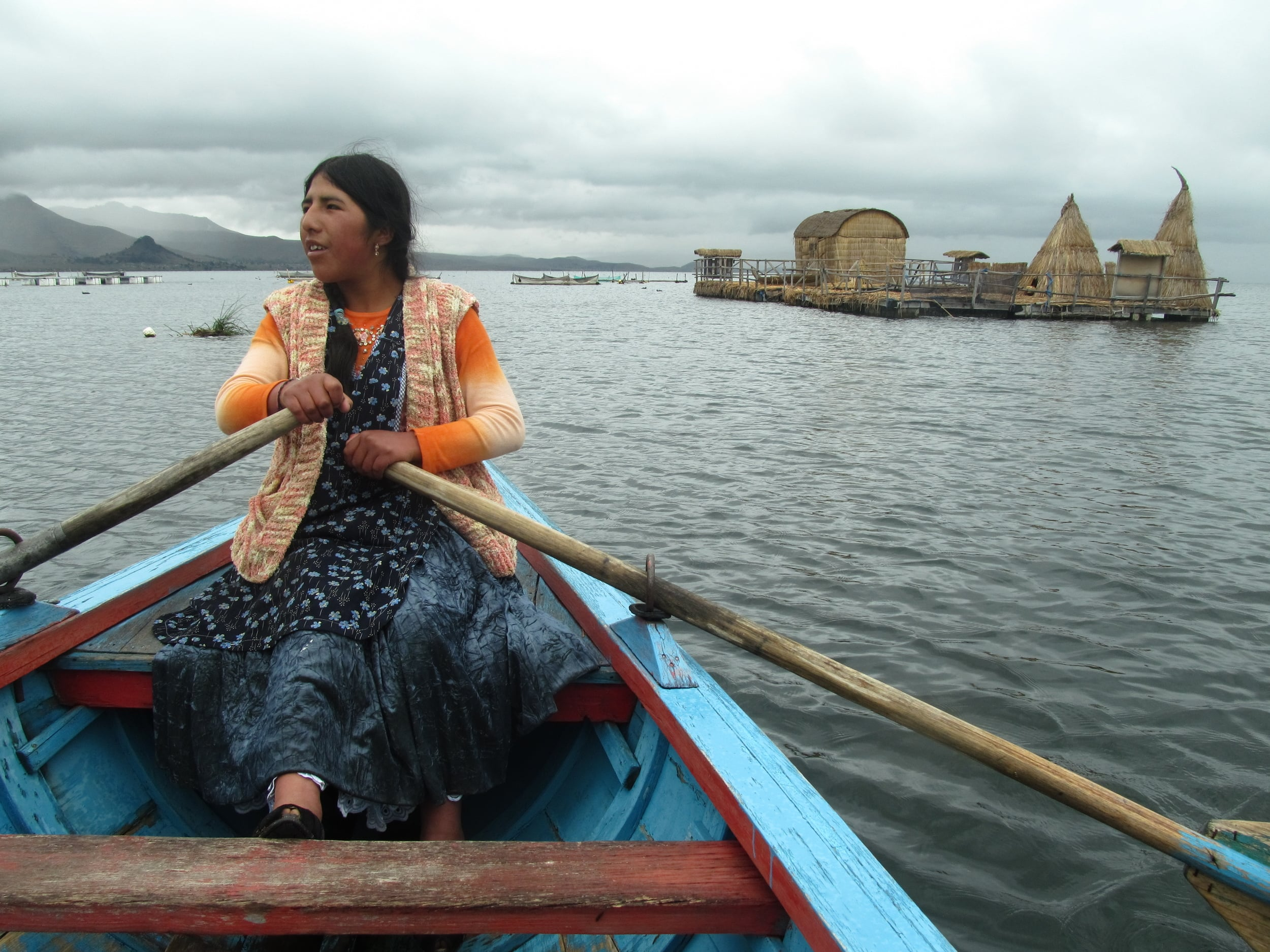 This women paddles us out to the grass island, which displays information on the water frog, a species found only in Lago Titicaca and threatened with extinction.