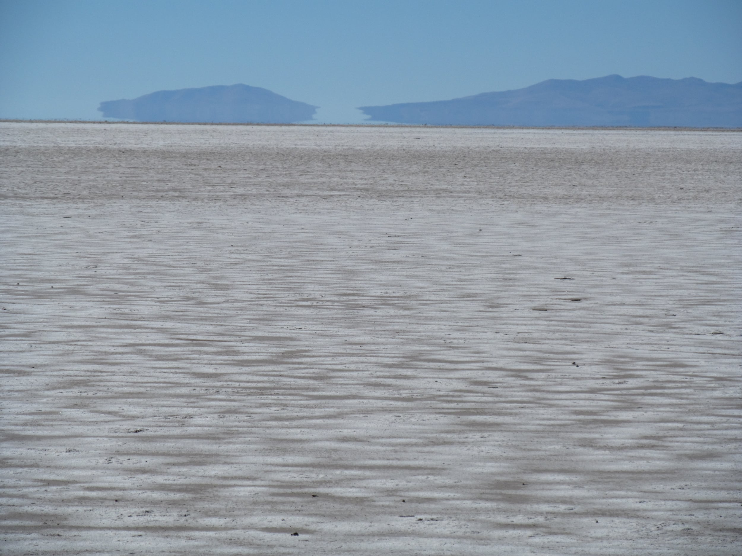 The islands look like they are floating as we finally cycle on Salar de Coipasa.