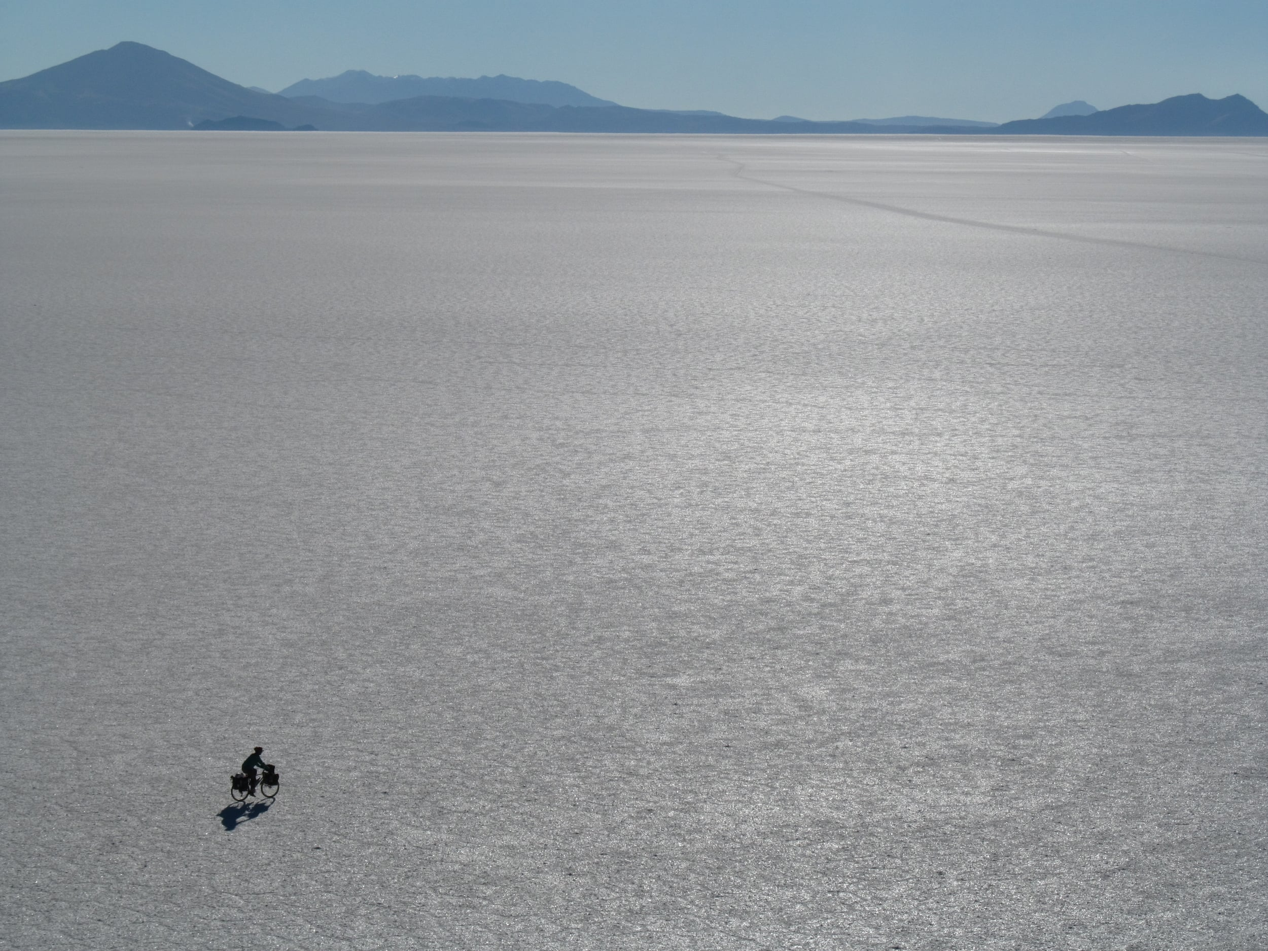 Nia bikes off route to an island in the middle of the salar. Jeep tracks can be found when you want to follow them.