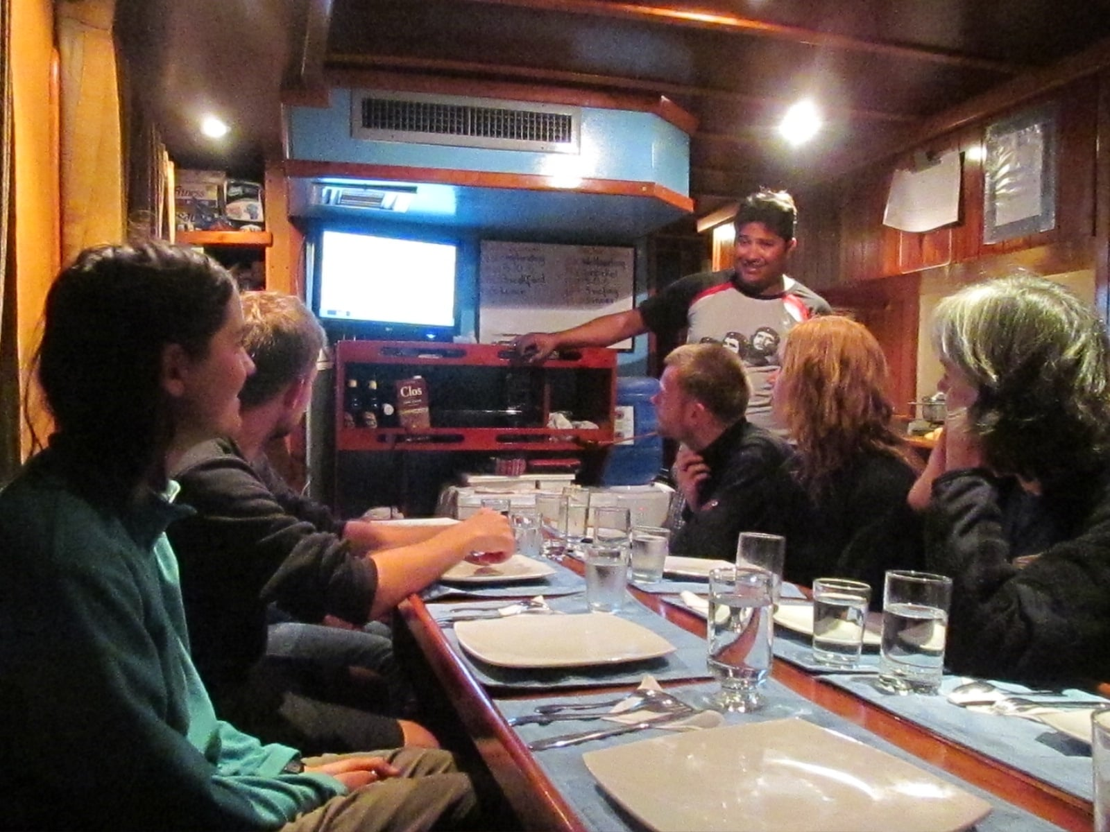 Our boat was cosy, at this table we ate, read and learned about  the places we would visit.
