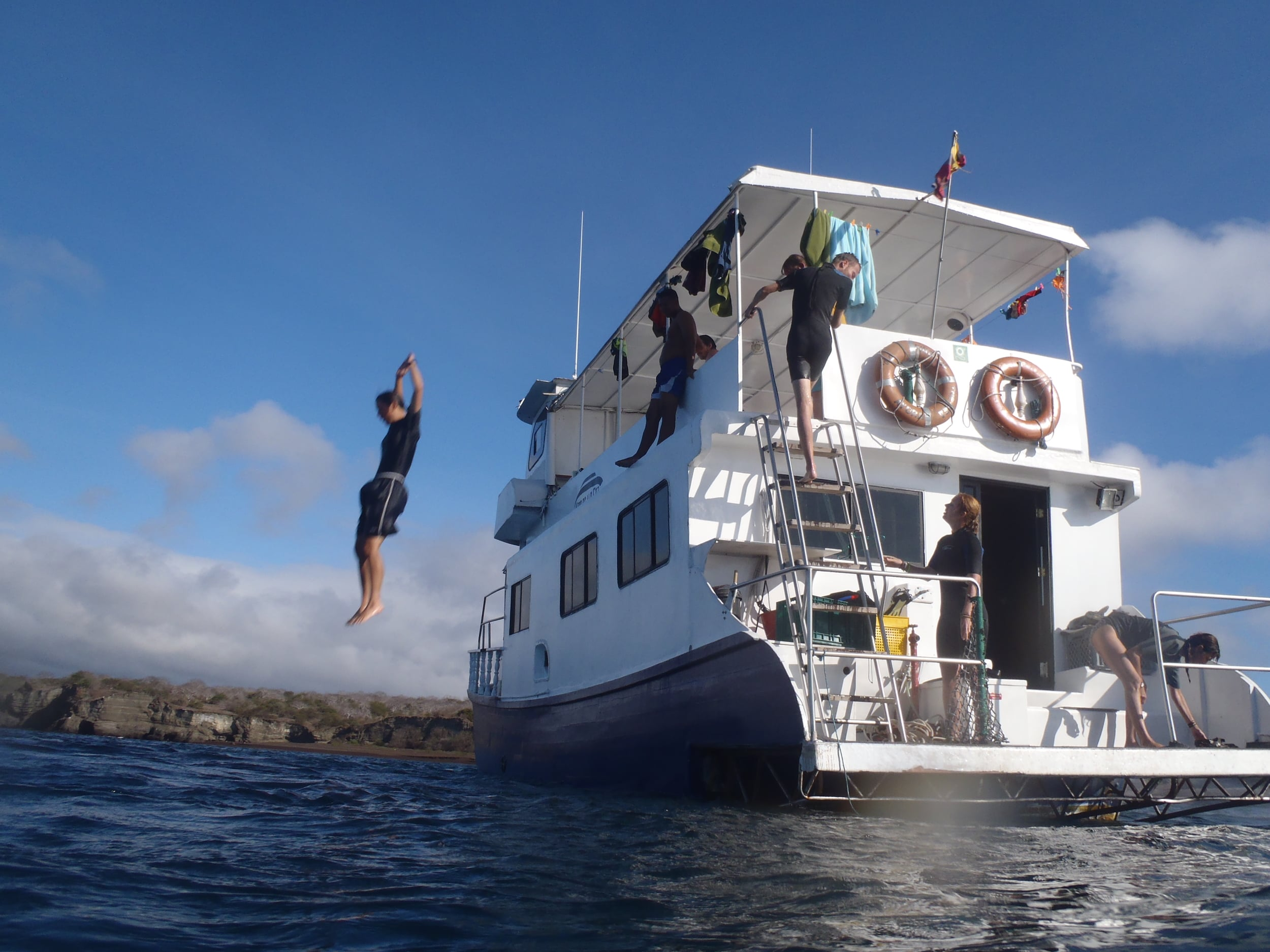 Nia jumps from our boat, the King of the Sea.