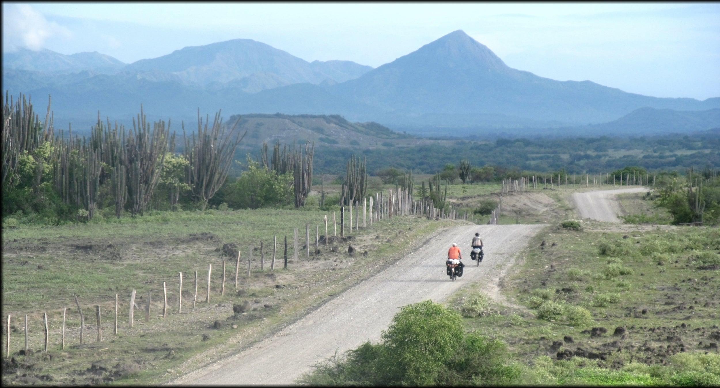 Virgile and Nia bike towards the desert.