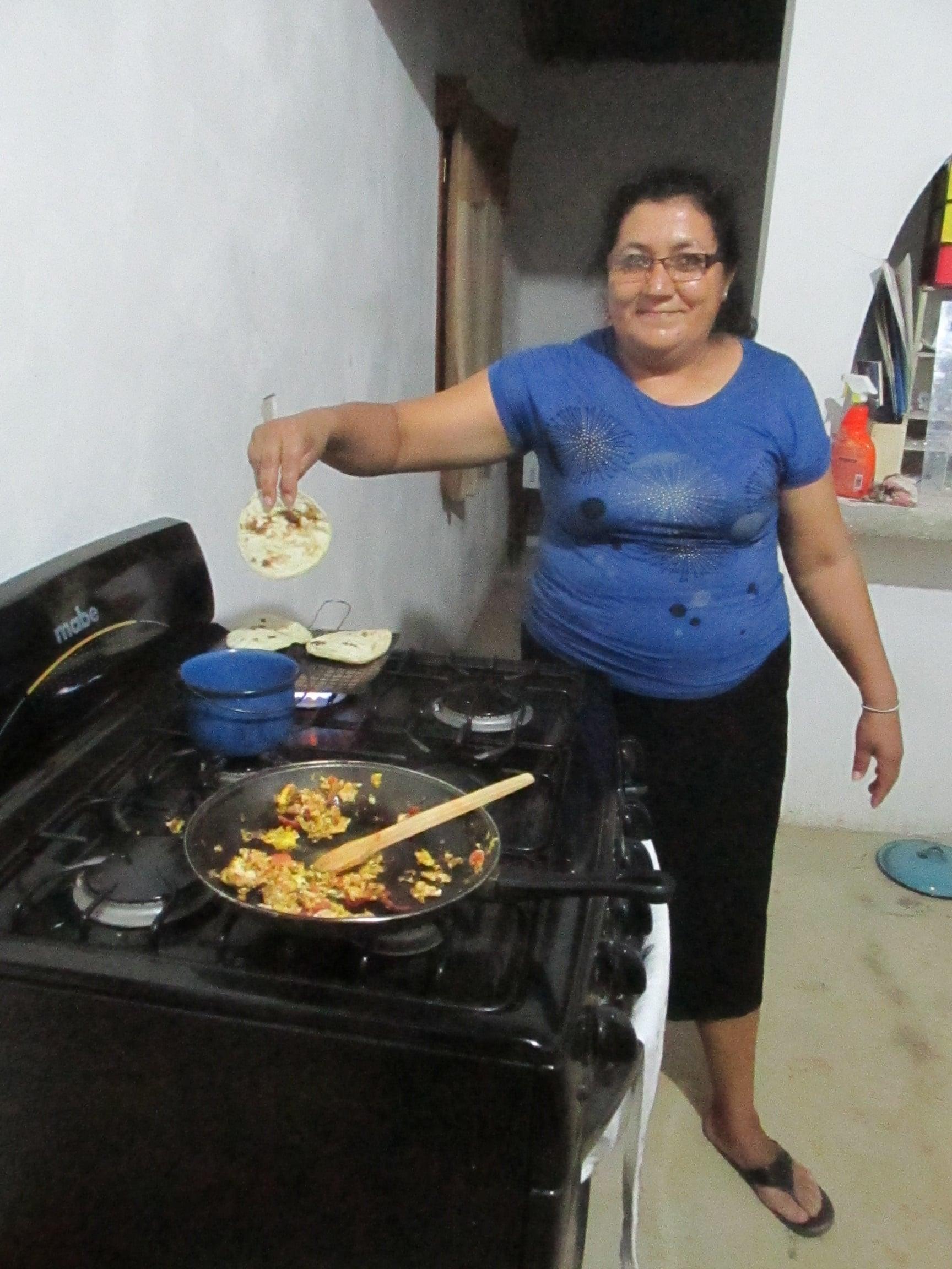 Mireira shows off her delicious corn tortillas.