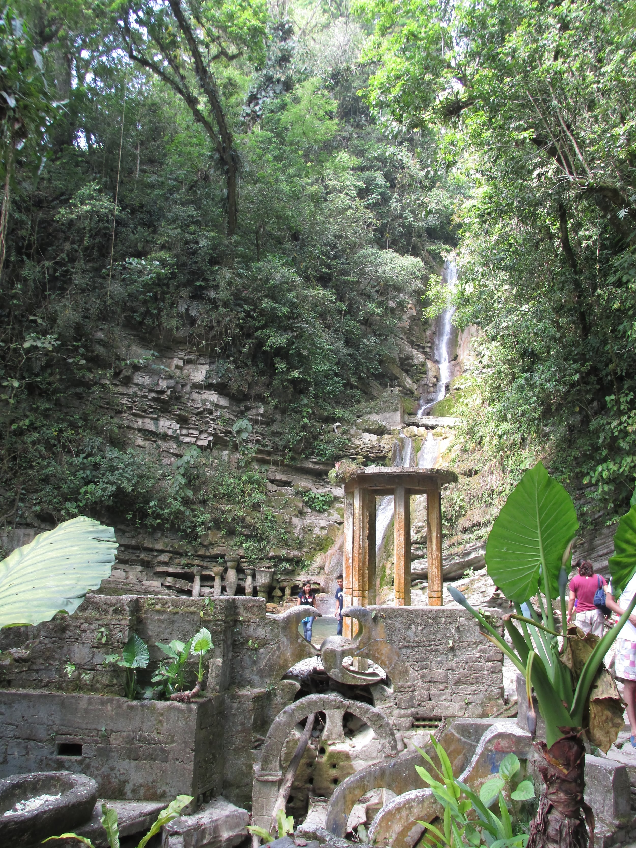 Waterfalls cascade down around the works.