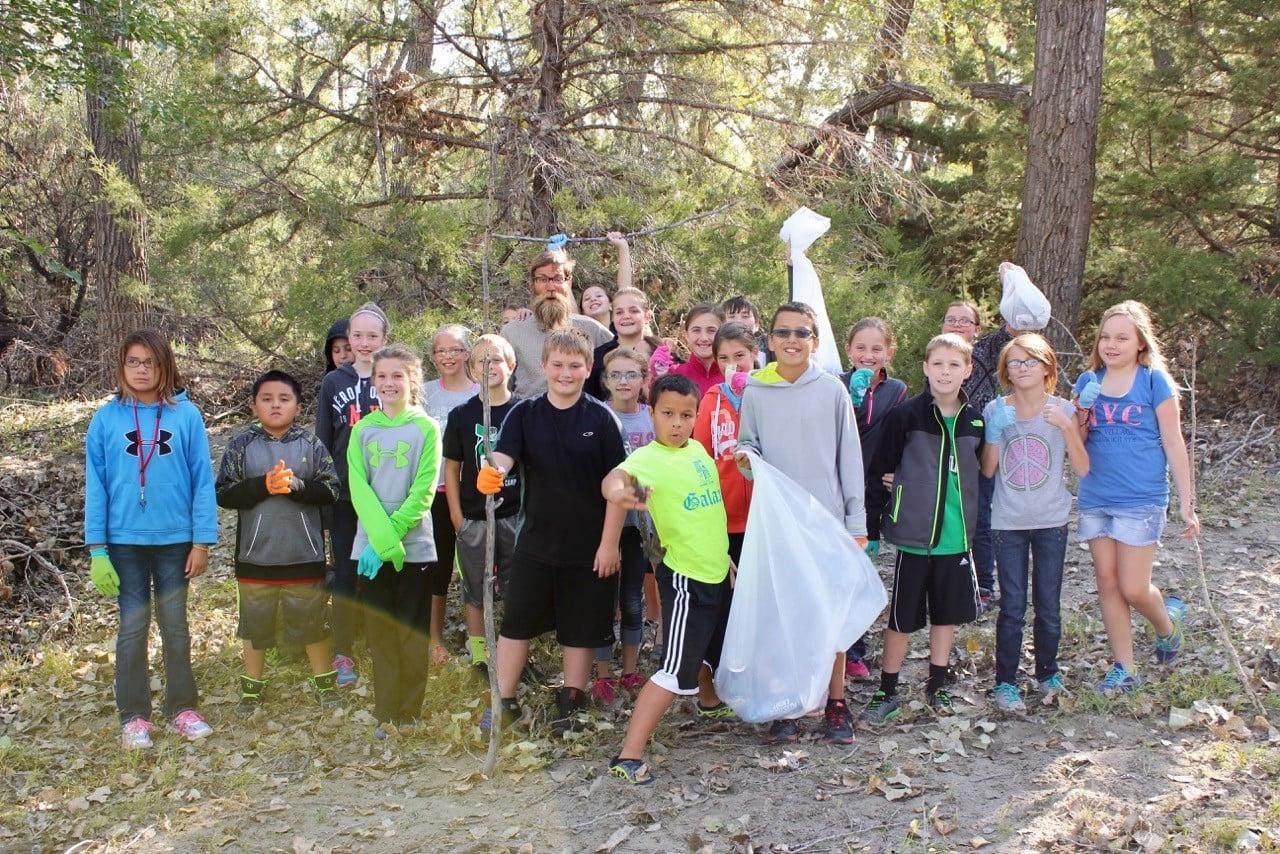 A trash pick up allows these sixth grade students to help the river they just learned about.