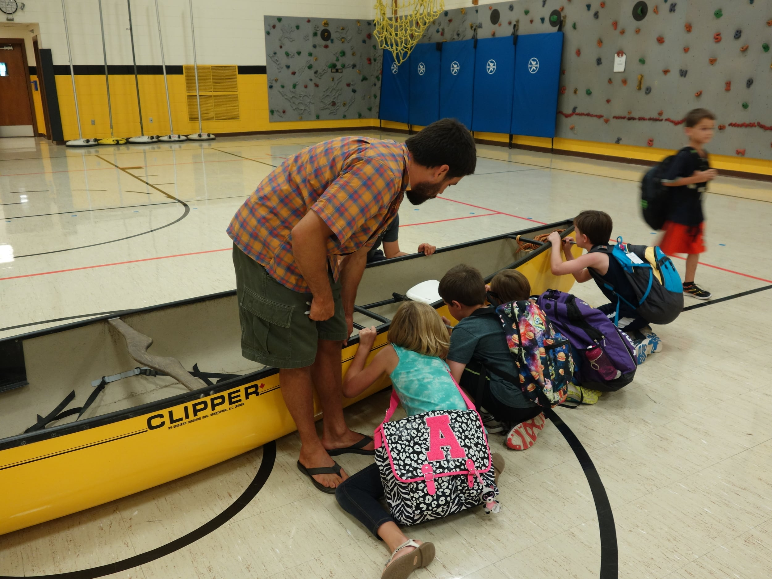 Every presentation varied a bit depending on the needs of the school. Here grades that didn't go on a field trip were able to pledge their support to the river by signing our canoe after a presentation.