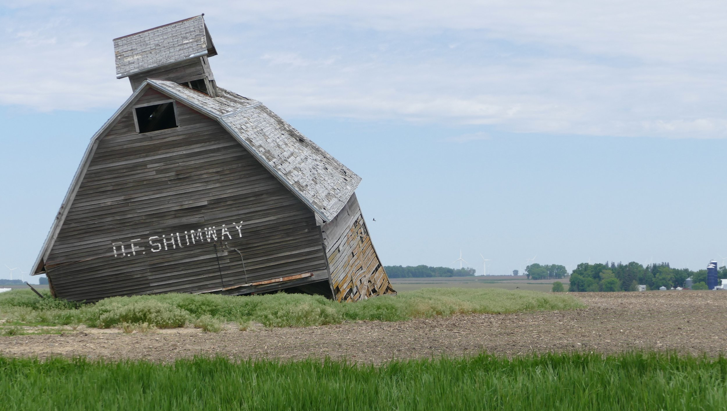 I was starting to feel like this barn as I biked across Iowa, a bit weighted down by reality.