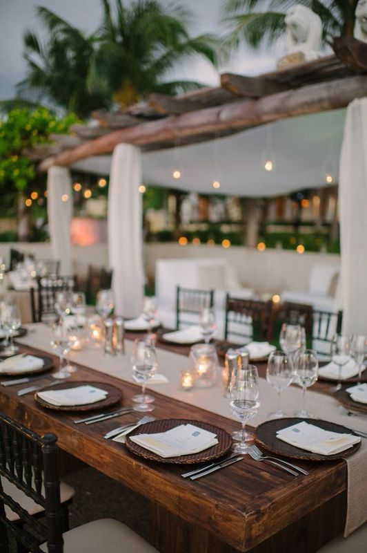8.  FROM THE SHORES OF PUNTA MITA, MEXICO:  Willow chargers , a  woven table runner  and in the distance... hanging luminaries . Can we live here for the summer? Cool, thanks.