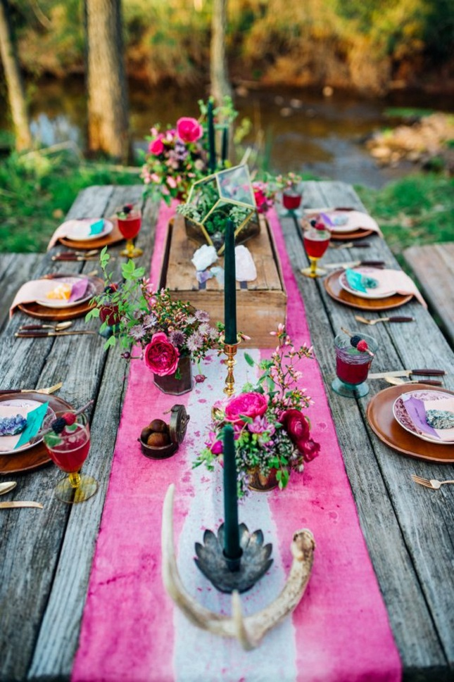 photography by PAULA  B ARTOSIEWICZ   BOHO CHIC   One of the things we love about summer is, it's an excuse to play with tie-dye and batik. Reason #1 why we've been eyeing this table since the first signs of spring. Nothing needs to be perfect, it just needs to be fun. Magenta, purple and turq linens mixed with colorful glass bottles, fruit, flowers and candles, and there you have it - Moroccan charm at the table!