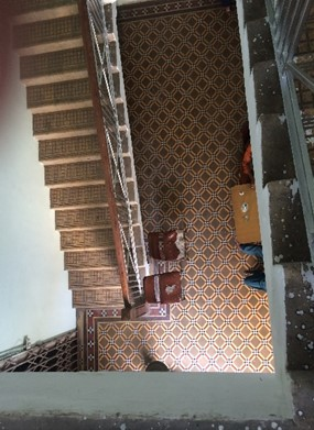 Original entrance floor tiles of Sarnagati Building viewed from first floor. Copyright Marvi Mazhar & Associates