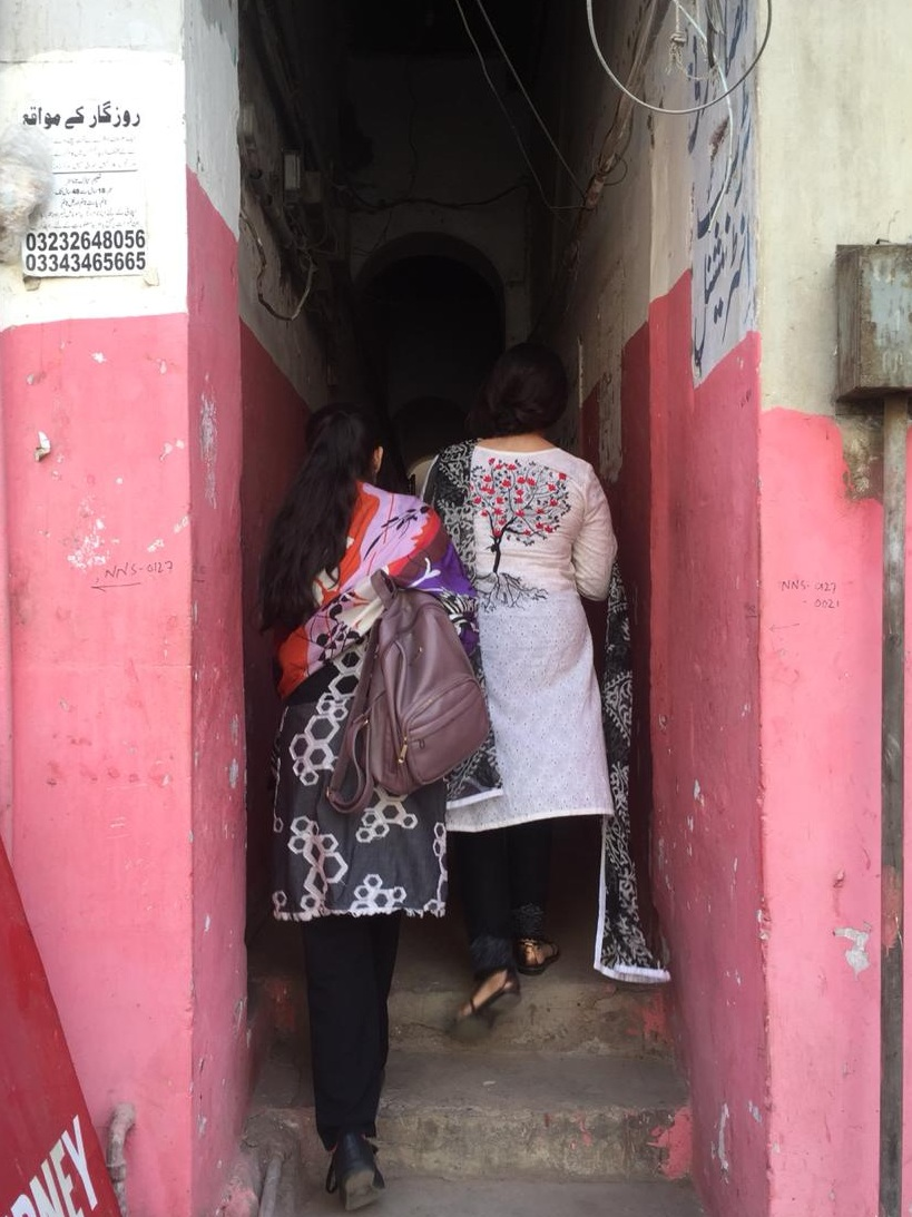 Two interns doing field work in the inner city route of Old Town, Karachi | Copyright Marvi Mazhar & Associates