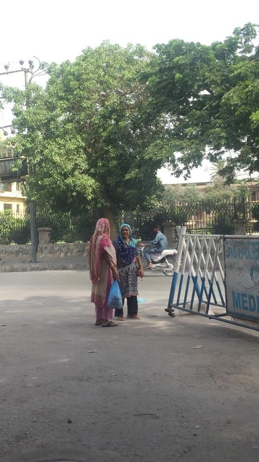 Two women waiting for transport | Copyright Marvi Mazhar & Associates