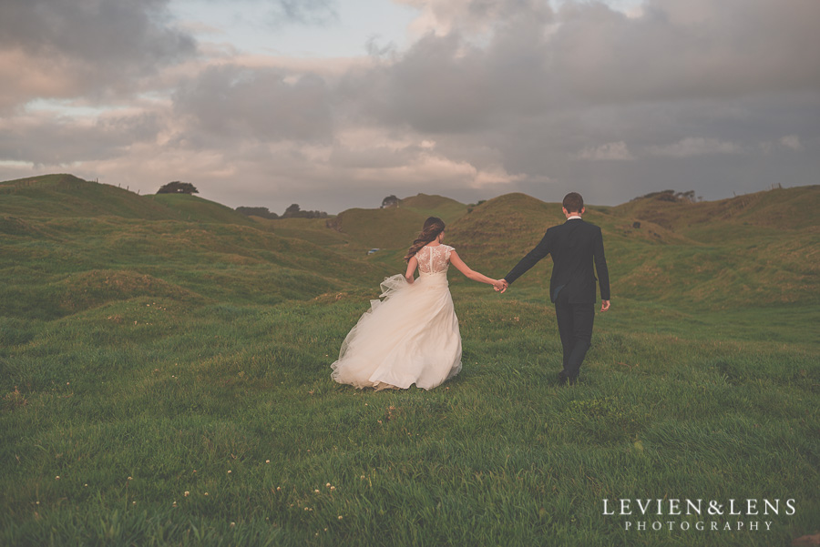 Bride and groom have their intimate moments walking on the hill