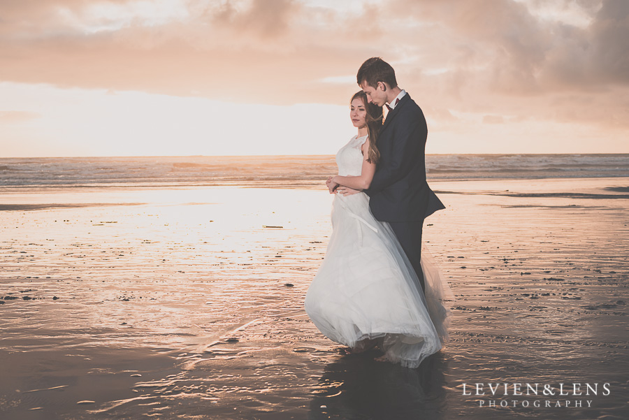 Bride and groom meeting sunset on the beach