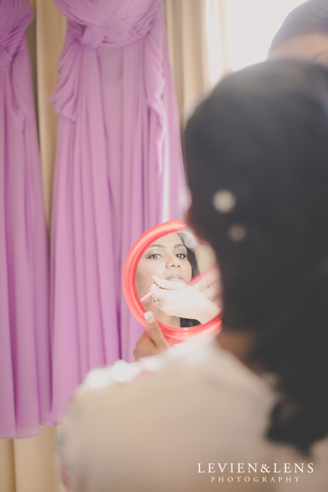 bride looking in mirror {Auckland-Waikato wedding photographer}