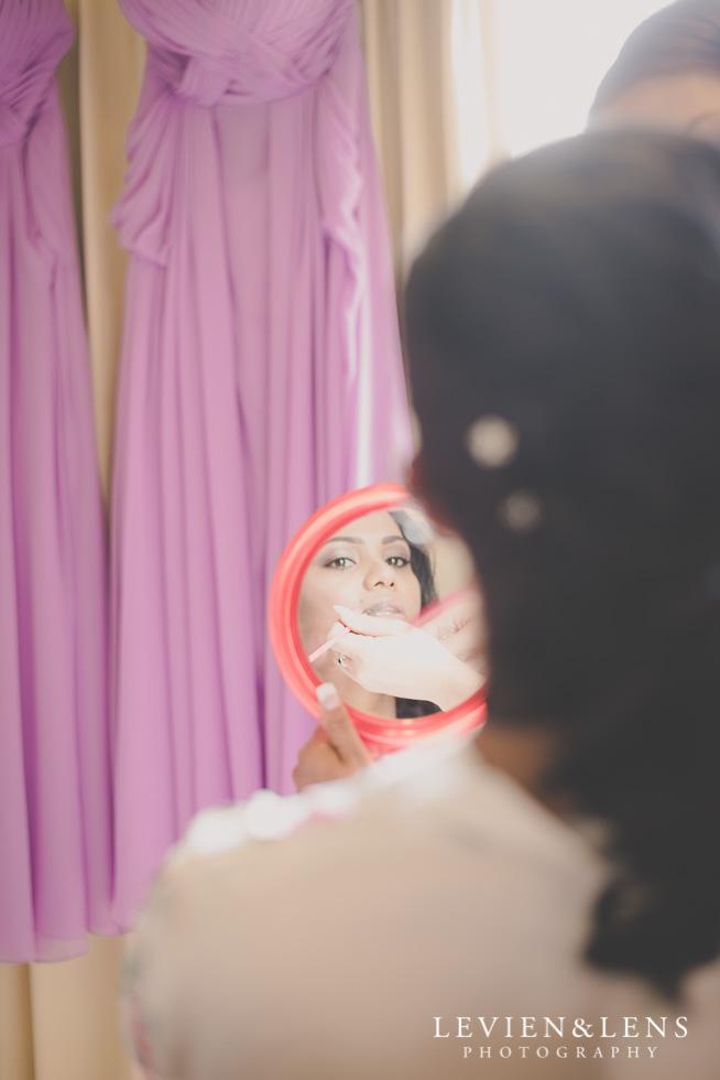 bride looking in mirror {Auckland-Waikato wedding photographer}