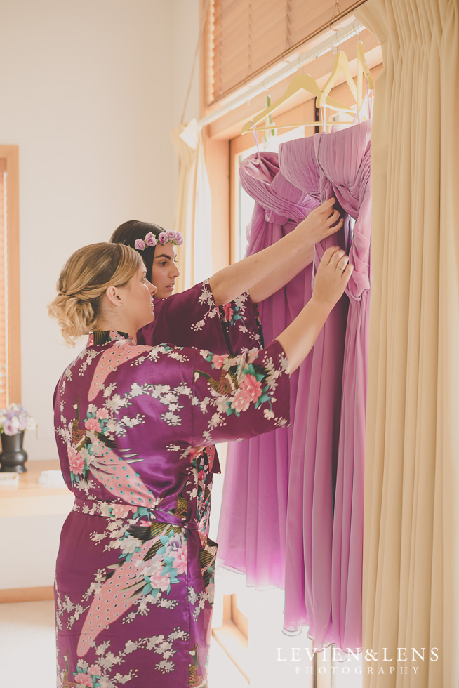 bridesmaids touching their dresses {Waikato-Bay of plenty wedding photographer}