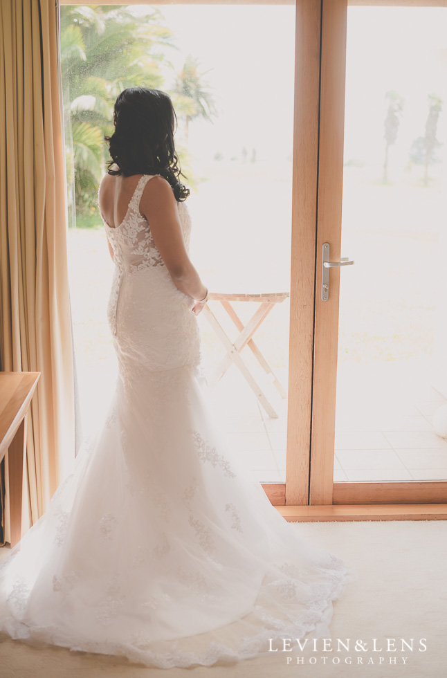 bride standing near window {Auckland wedding photographer}