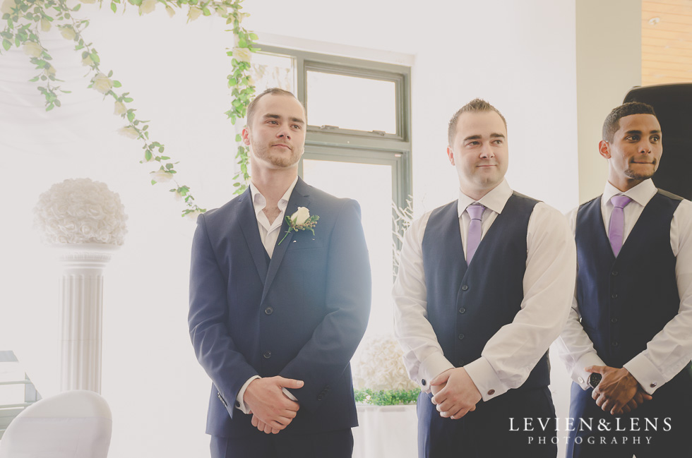 groom look at bride go down aisle {Auckland wedding photographer}