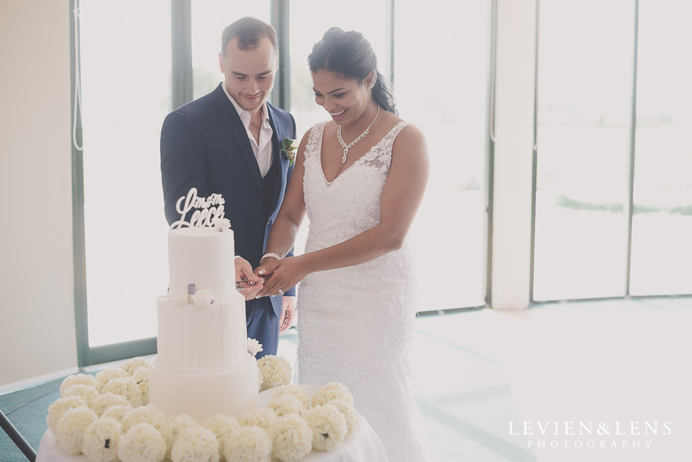 cake cutting - bride and groom reception details Formosa Golf Resort {Auckland wedding photographer}