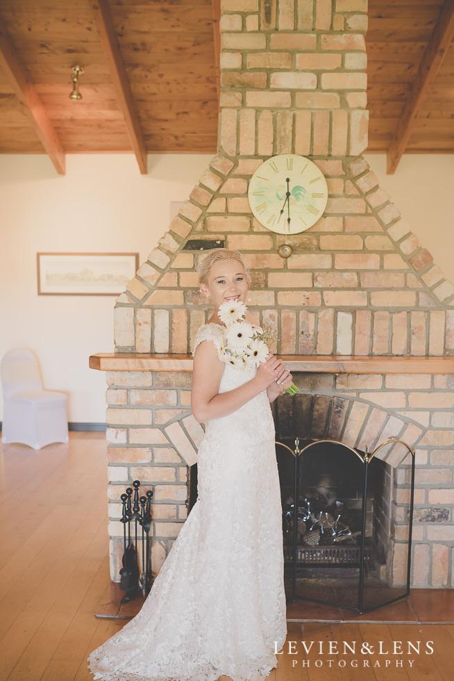 bride with flowers {Auckland-Hamilton wedding photographer} Footbridge Lodge