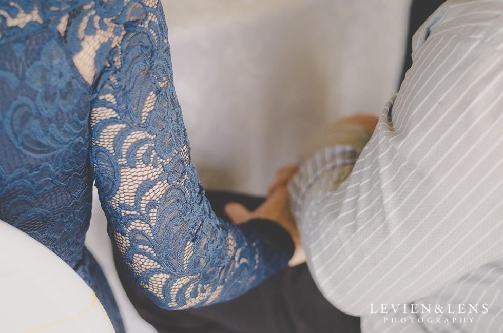 holding hands reception {Auckland-Hamilton wedding photographer}