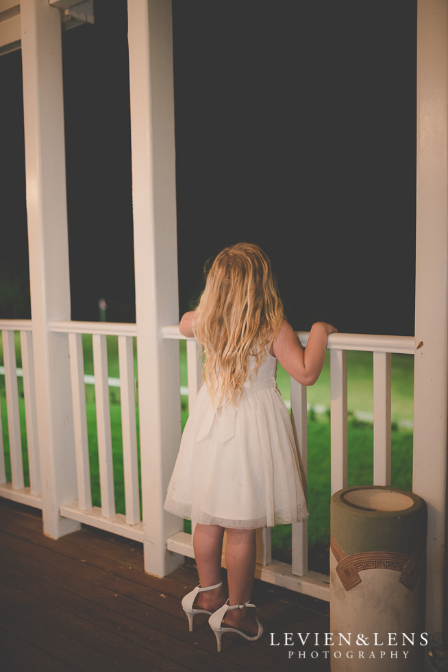 flower girl with big shoes reception {Auckland-Hamilton wedding photographer} Footbridge Lodge