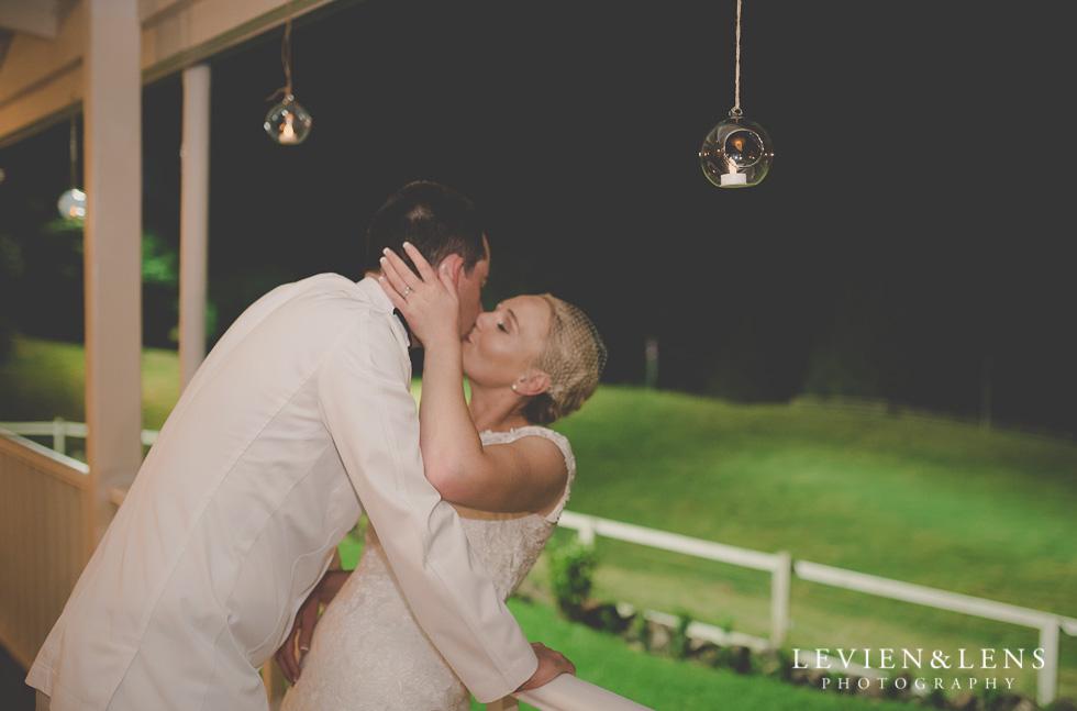 bride and groom kiss reception {Auckland-Hamilton wedding photographer}