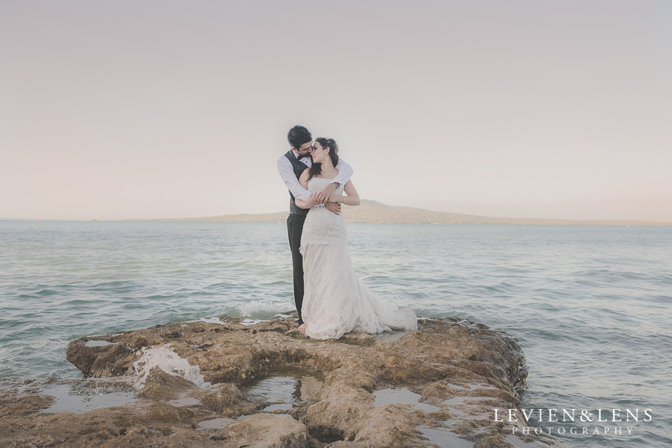 beautiful couple standing cliff St Heliers beach {Auckland-Hamilton-Tauranga wedding photographer}