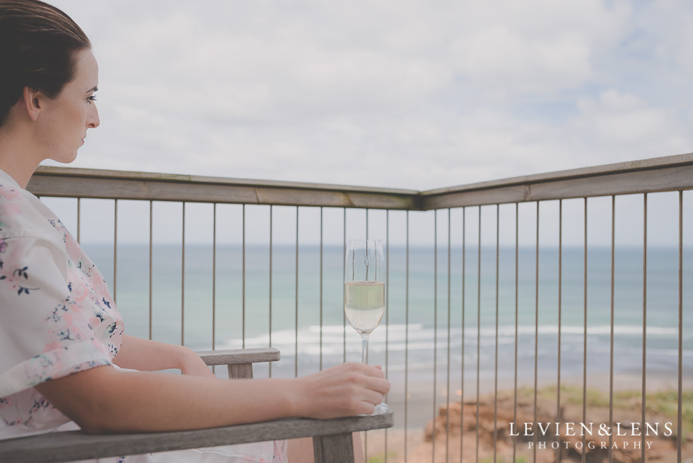 bride near ocean getting ready Castaways Resort - Kariotahi beach wedding {Auckland lifestyle couples-engagement photographer}