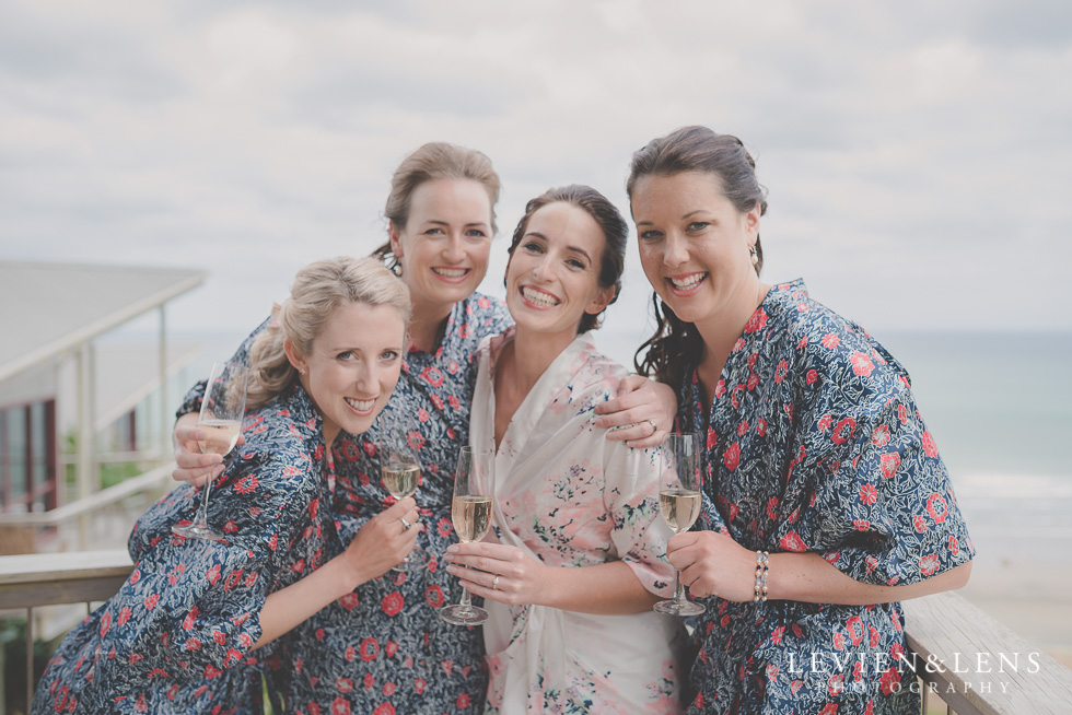 bride and bridesmaids getting ready Castaways Resort - Kariotahi beach wedding {Auckland lifestyle couples-engagement photographer}