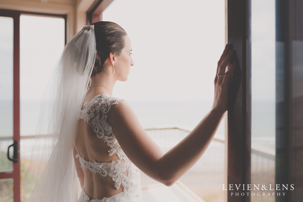 bride near window Castaways Resort - Kariotahi beach wedding {Auckland lifestyle couples-engagement photographer}
