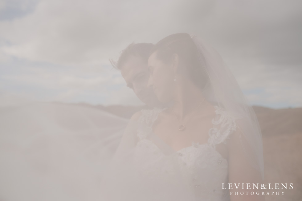 couple with blowing veil {Auckland-Waikato-Bay of Plenty wedding-engagement photographer} Early Bird special