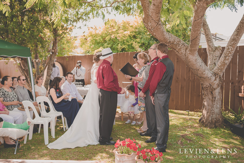 father give daughter a way small family garden wedding ceremony {Auckland lifestyle couples-engagement photographer}