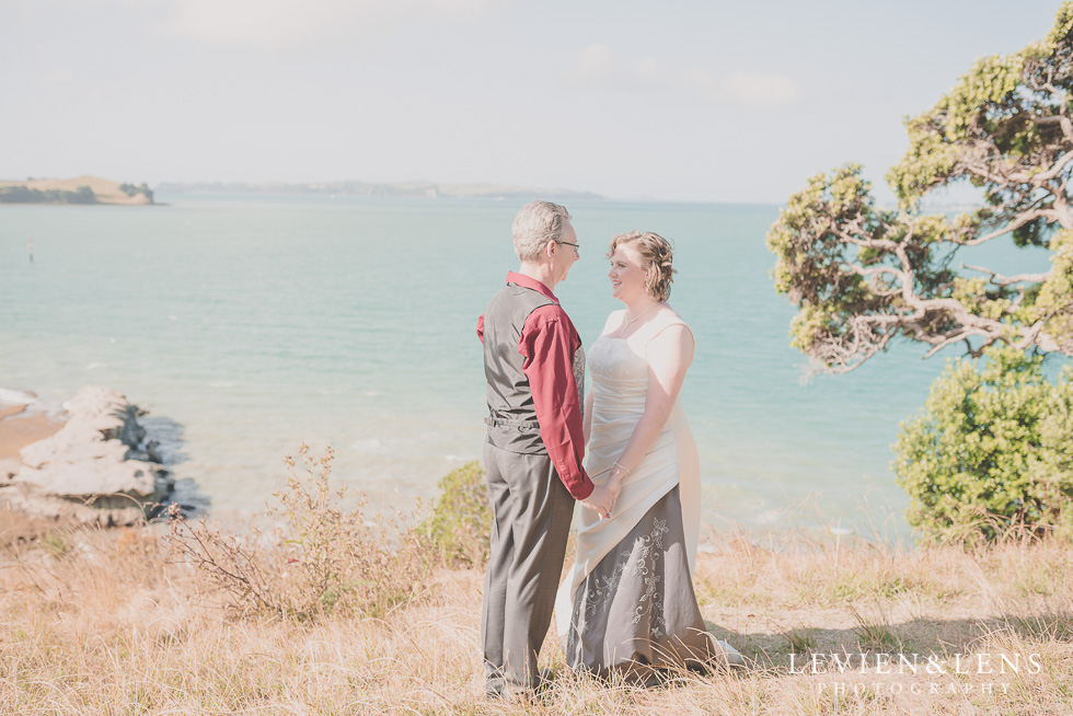 couple standing at costal side Musick Point {Auckland lifestyle wedding-engagement photographer}