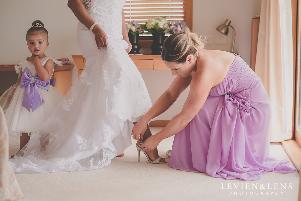 bride putting shoes on {Auckland-Hamilton-Tauranga lifestyle wedding-couples-engagement photographer}