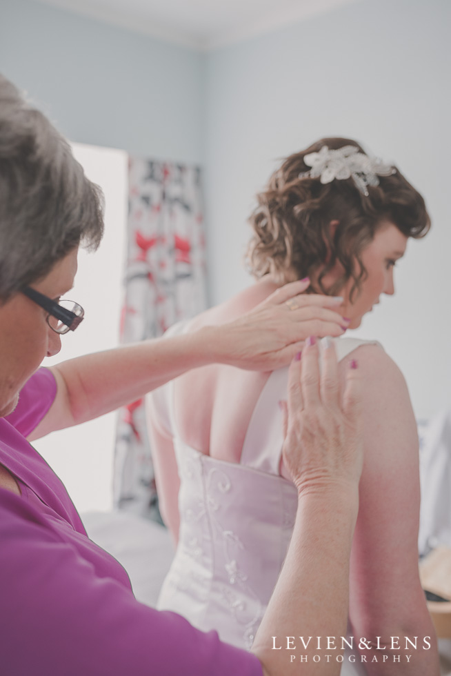 mother helping bride with dress {Auckland-Hamilton-Tauranga lifestyle wedding-couples-engagement photographer}