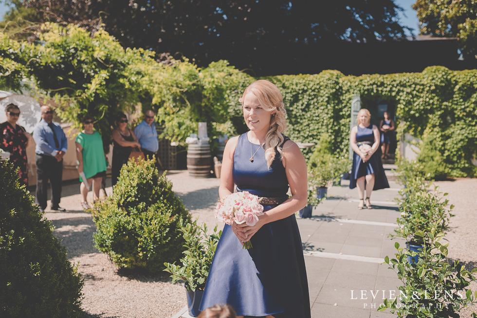 bridesmaids walking down aisle {Tauranga-Bay of Plenty wedding-couples-engagement photographer}