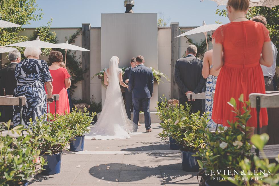 bride and groom on ceremony {Tauranga-Bay of Plenty wedding-couples-engagement photographer}