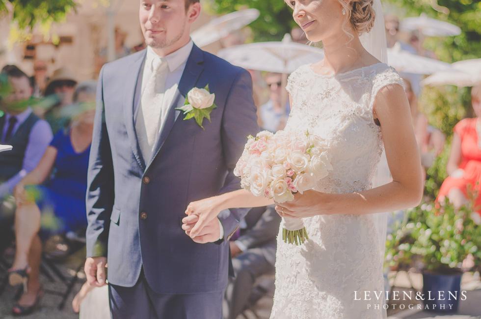 bride and groom holding hands {Tauranga-Bay of Plenty wedding-couples-engagement photographer}