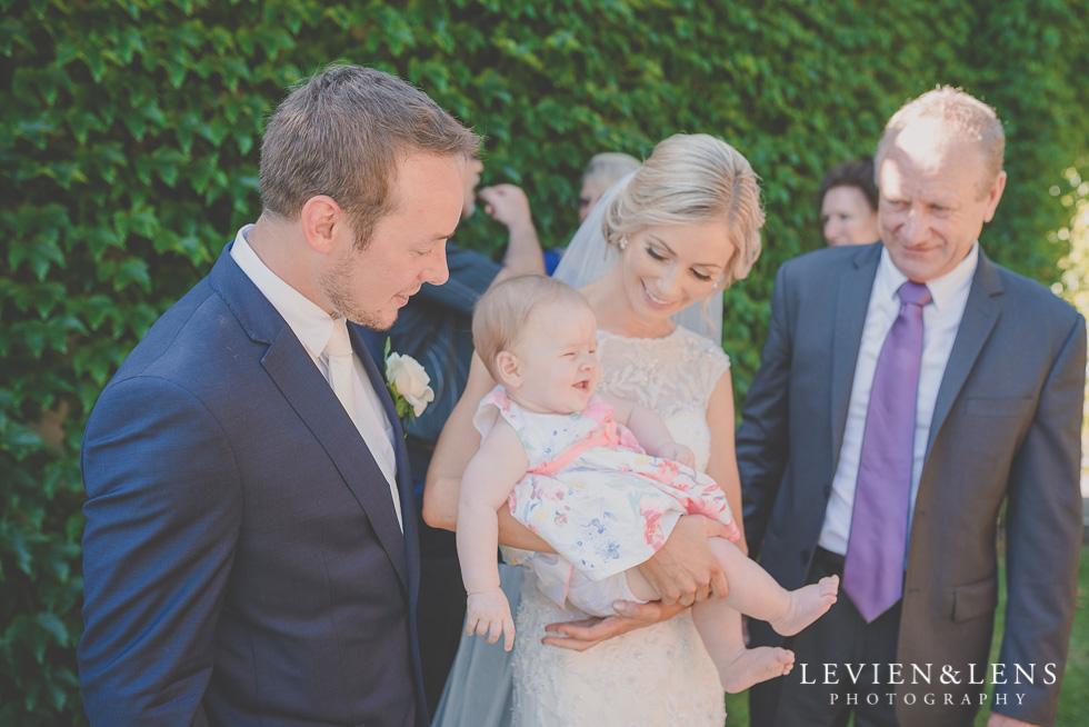 bride holding baby {Tauranga-Bay of Plenty wedding-couples-engagement photographer}
